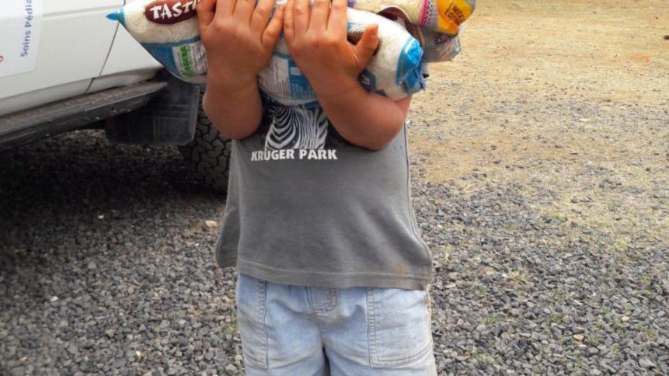 Soli Deo Gloria child carrying food